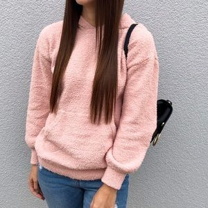 Fuzzy pink hoodie.